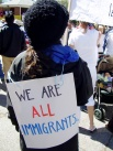"""""""we are all immigrants"""" sign"""